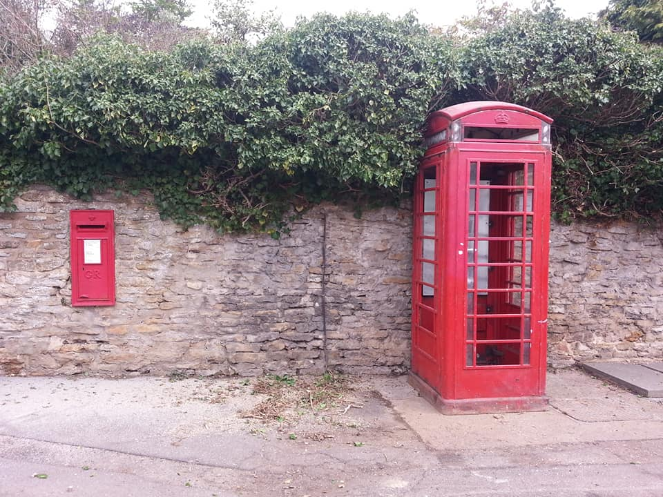 Red phonebox for defibrillator installed
